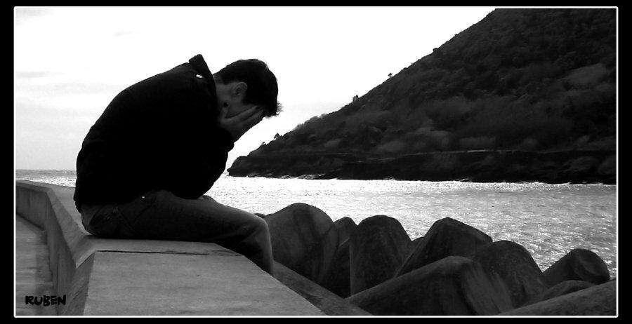 alone-sad-boy-sitting-near-beach