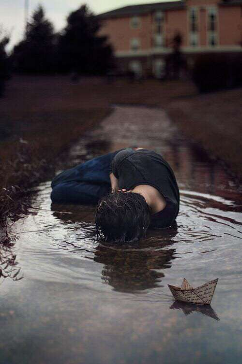 alone-boy-on-road-in-rain-paper-boat-lovesove