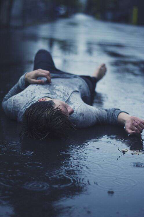 alone-sad-boy-lying-on-road-lovesove