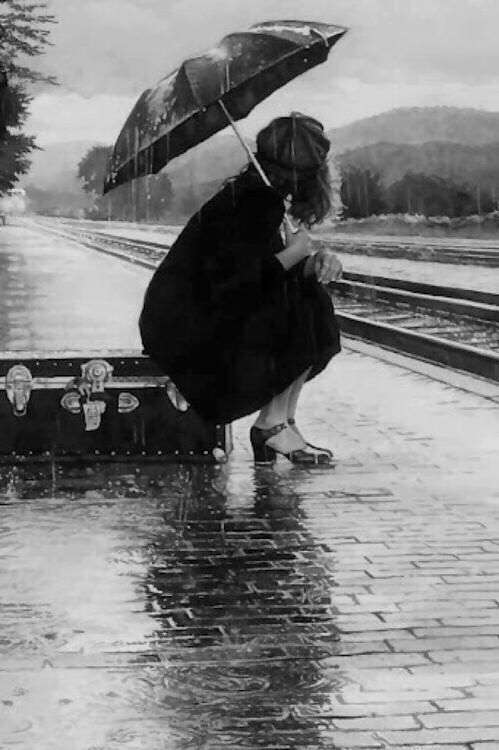 sad-girl-sitting-alone-in-rain-lovesove