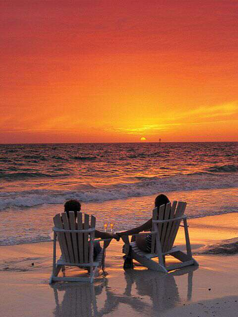 couple-sitting-together-beach-sunset-lovesove