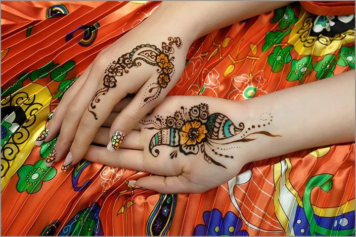 50+ Mesmerising Mehndi Designs For Ceremonies & Wedding, Wedding Mehndi Designs, orange flower with blue accents mehndi design
